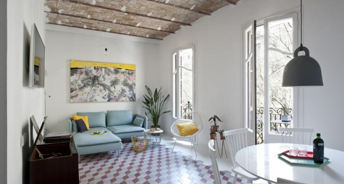 wohnzimmer esszimmer runder esstisch pendelleuchte sofa bodenfliesen geometrische muster
