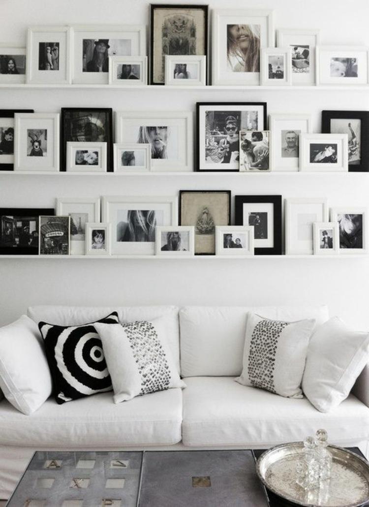 Fotowand Ideen Bilderleisten Wand dekorieren Wohnzimmer Fotos schwarz ...