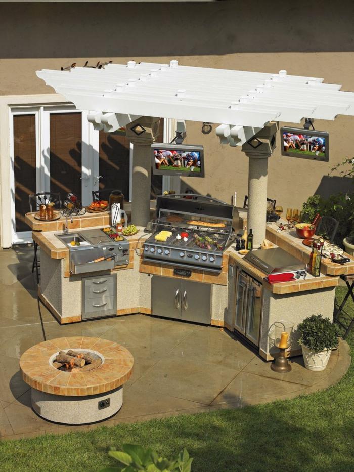 außenküche selber bauen küchenmodule flexibel holzpergola säulen runde feuerstelle