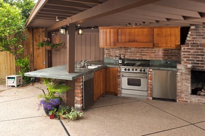 außenküche selber bauen ziegelsteine wand holzschränke kamin