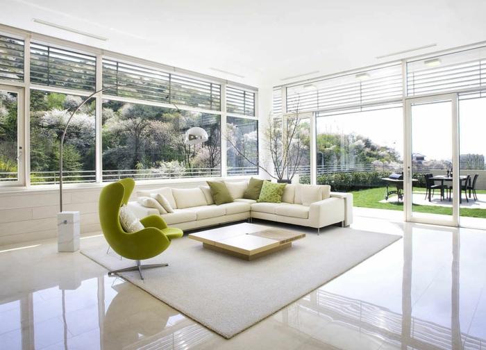 bequeme sessel grüner sessel weißer teppich wohnzimmer einrichten