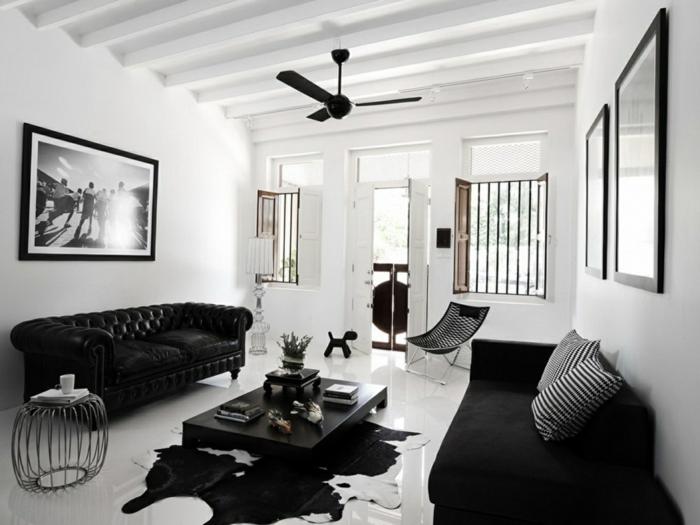 chesterfield sofa schwarz fellteppich weiße wände