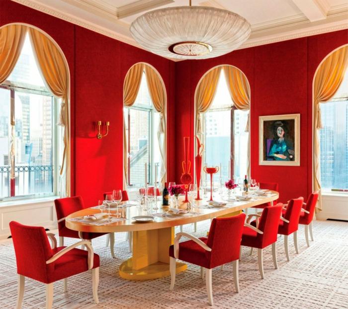 esszimmer einrichten rote wandfarbe ovaler esstisch rote stühle