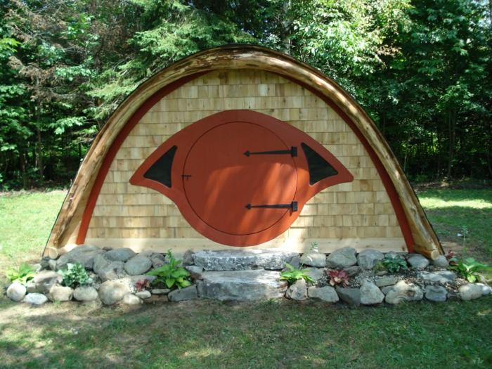 gartenhaus selber bauen natursteine holz runde türöffnung