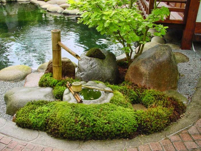 japanischer garten bambus brunnen gestalten natursteine gartenteich grüne pflanzen