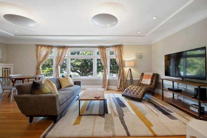 moderne sessel wohnzimmer einrichten stilvoller teppich ledersessel