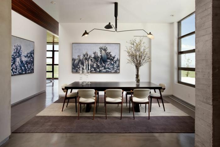 modernes esszimmer stilvolle möbel teppich wanddeko kerzen