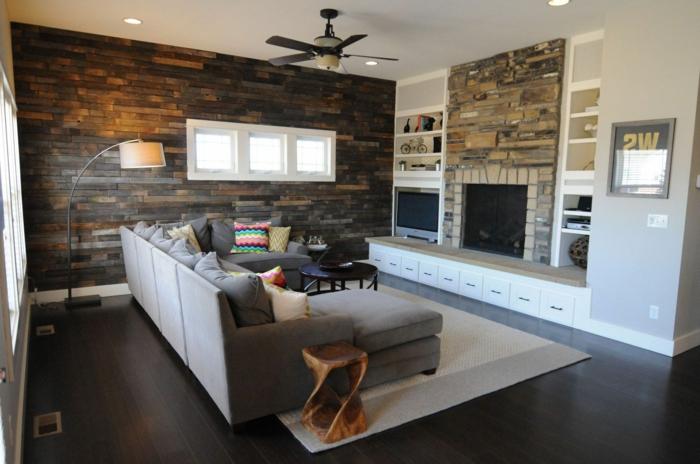 steinwand wohnzimmer akzentwand rustikaler beistelltisch teppich