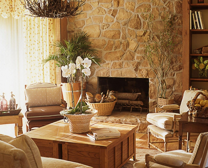 steinwand wohnzimmer hözterner couchtisch kamin ländlich