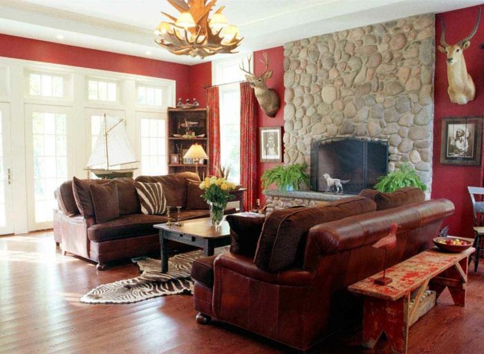 steinwand wohnzimmer zebra teppich rustikale sitzbank