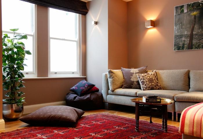teppich wohnzimmer rot bodenkissen topfpflanze