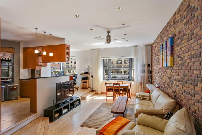 wohnzimmer modern einrichten rustikaler couchtisch küche ziegelwand