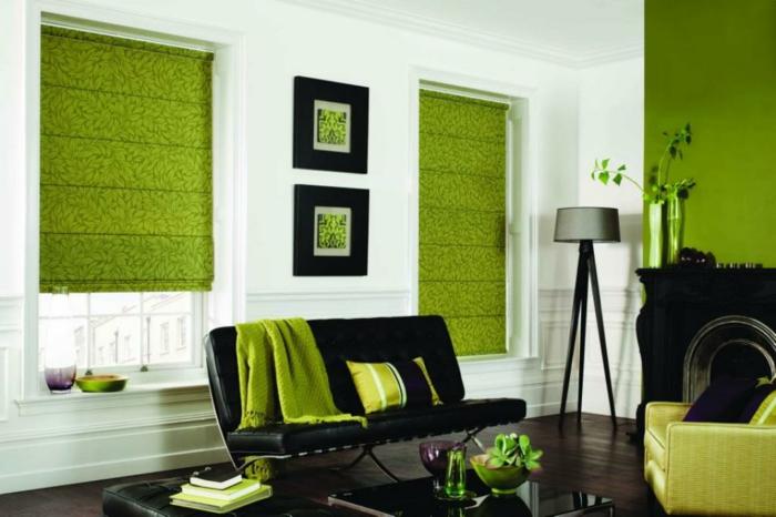 wohnzimmer sessel grüner sessel schwarzes sofa grüne akzente