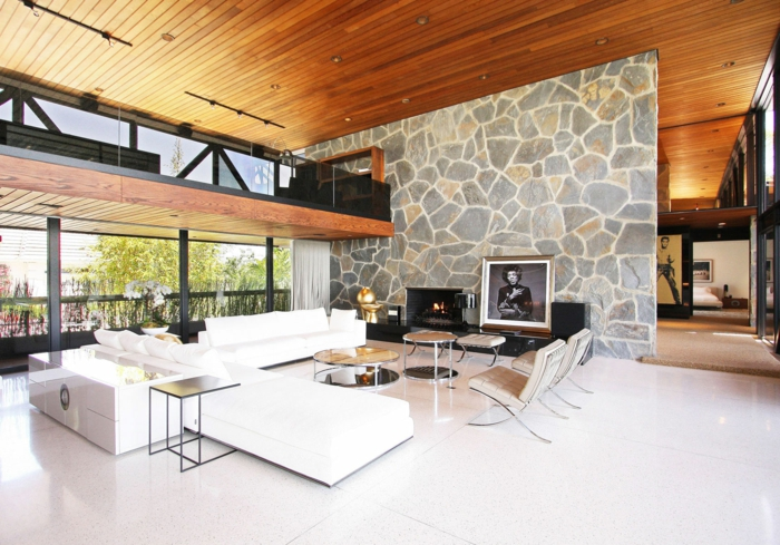 wohnzimmer sessel retro:Steinwand Wohnzimmer – 43 Beispiele, wie Steine auf das Ambiente