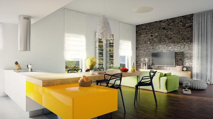 wohnzimmer steinwand offener wohnplan grünes sofa