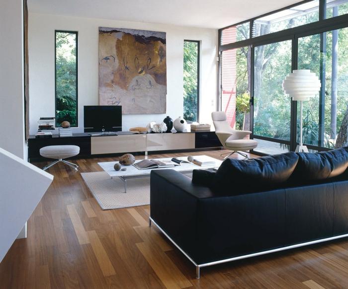 wohnzimmerteppich eleganter teppich weiße wandfarbe schwarzes sofa