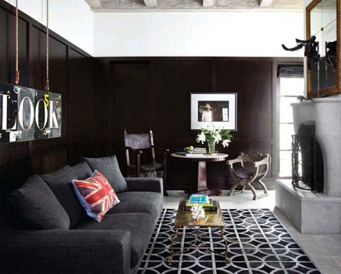 wohnzimmerteppich luxuriös dunkelgraues sofa schwarze wände