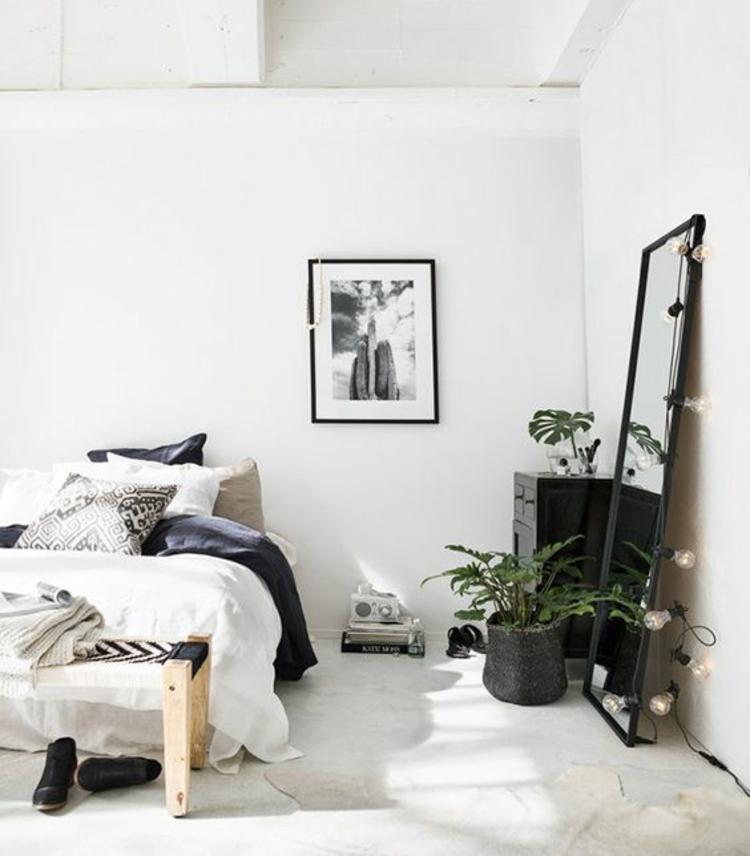 Wohnung einrichten Schlafzimmer Möbel Bett Wandspiegel Zimmerpflanzen
