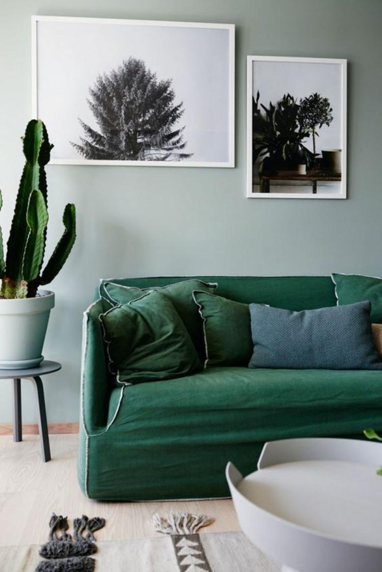 Wohnung einrichten Tipps Wohnzimmer Sofa dunkelgrün Kaktus