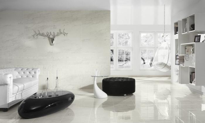 bodenbelag wohnzimmer luxuriöse bodenfliesen ovaler couchtisch schwarze akzente