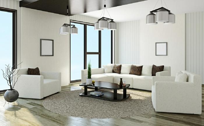 ecksofa weiß elegant runder teppich braune dekokissen