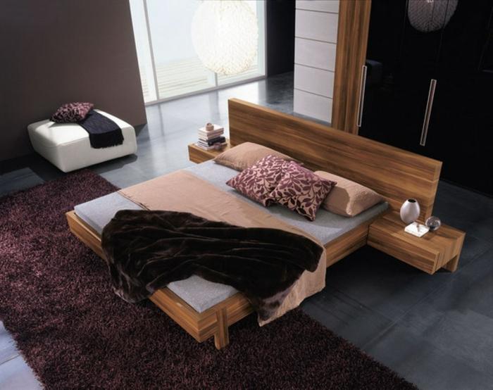 einrichtungsideen schlafzimmer funktionales bett teppich braune wände