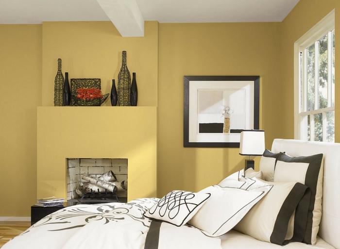 einrichtungsideen schlafzimmer gelbe wandfarbe kamin