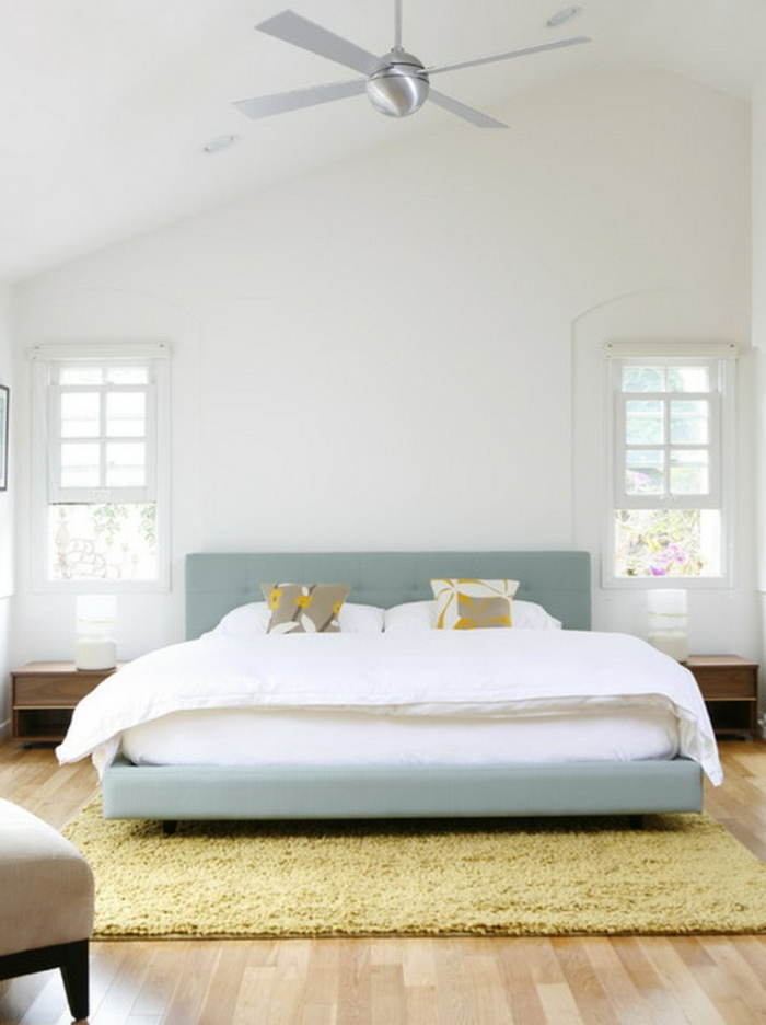 einrichtungsideen schlafzimmer schlicht hellgrüne akzente gelber teppich