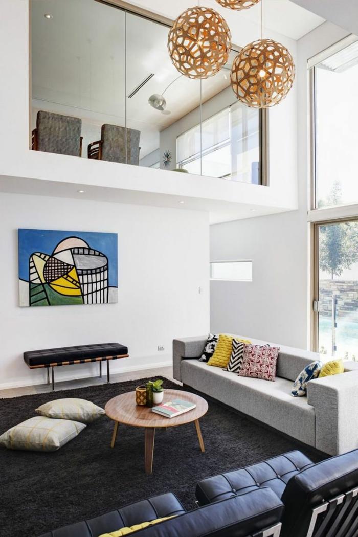 einrichtungsideen wohnzimmer dunkelgrauer teppich runder couchtisch weiße wände