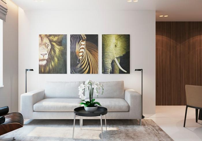 einrichtungsideen wohnzimmer wanddeko bilder eleganter teppich helle wände