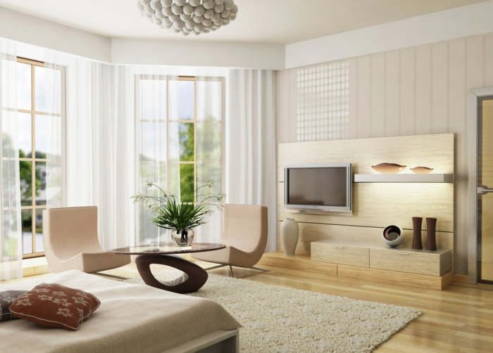 kleine wohnung einrichten helle holz wohnwand dekoartikel designer möbel hängeleuchte sessel runder couchtisch