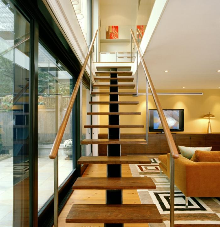 modern einrichten innentreppen geometrischer teppich gelbe wände
