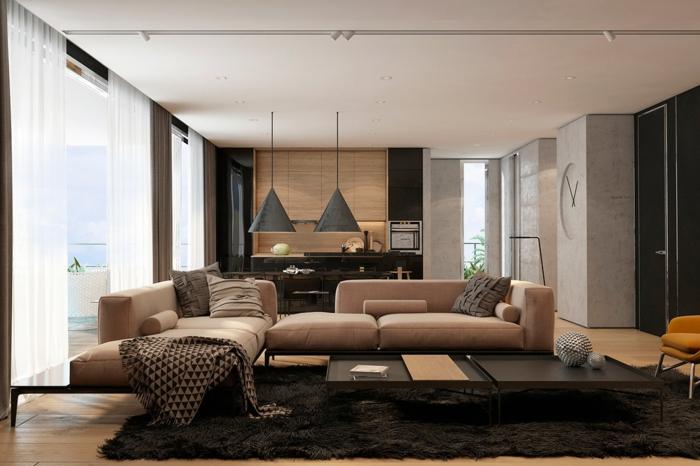 modern einrichten schwarzer teppich beige möbel offener grundriss hängeleuchten