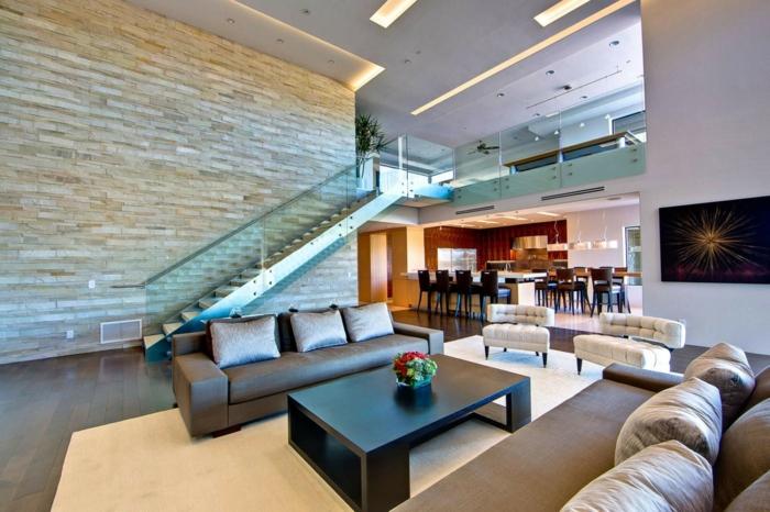 modern einrichten wohnzimmer teppich steinwand akzentwand