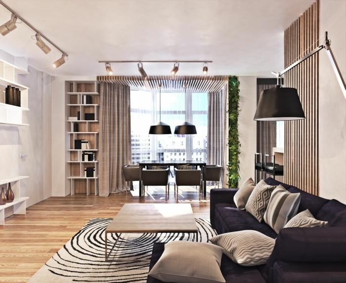 modern einrichten wohnzimmer teppichmuster dunkles sofa essbereich helle wände grüne akzente