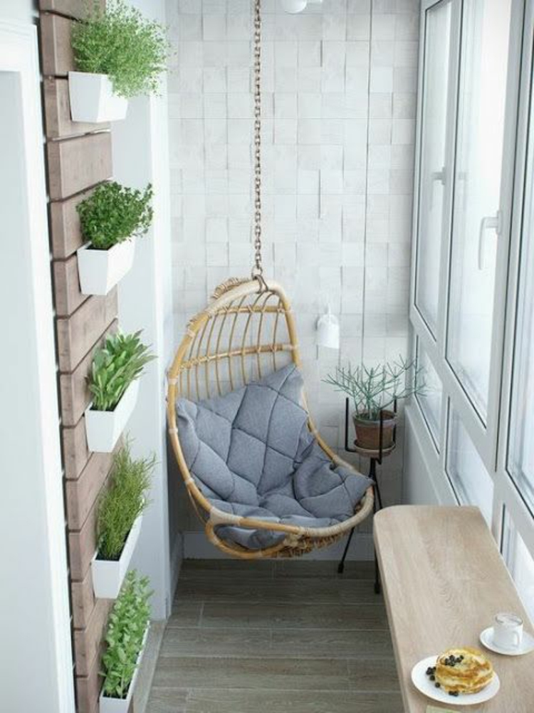 moderne Terrassengestaltung Bilder Hängekorbsessel vertikaler Garten