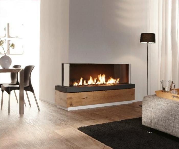moderne feuerstellen minimalistisch wohnbereich schwarzer teppich