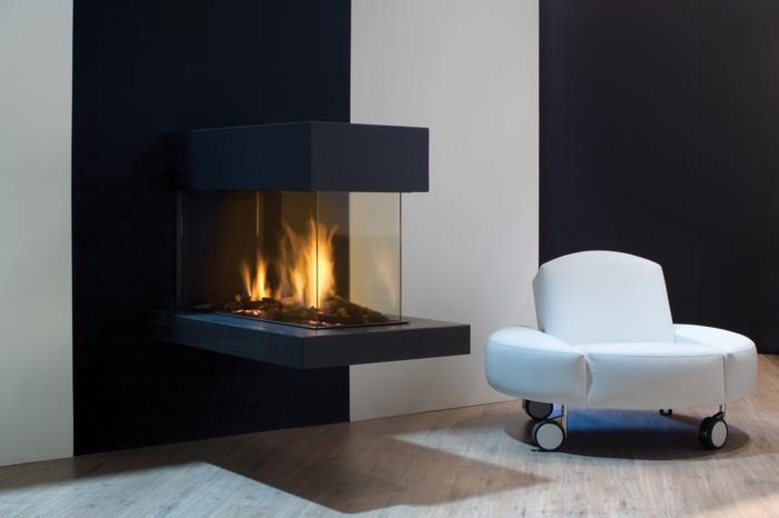 moderne feuerstellen wandfarbe weiß schwarz weißer sessel