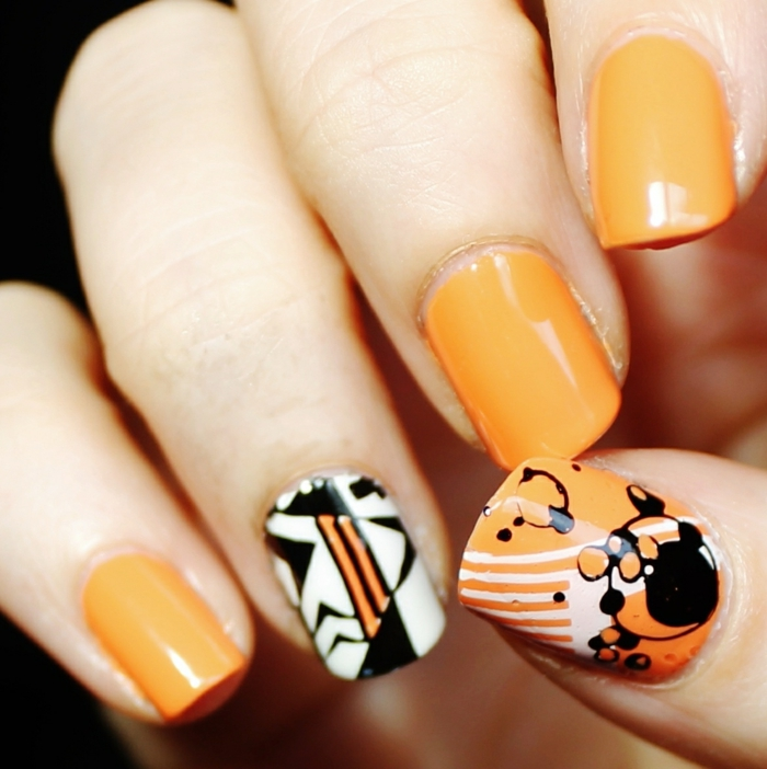 nageldesign fotos geometrische figuren orange trends