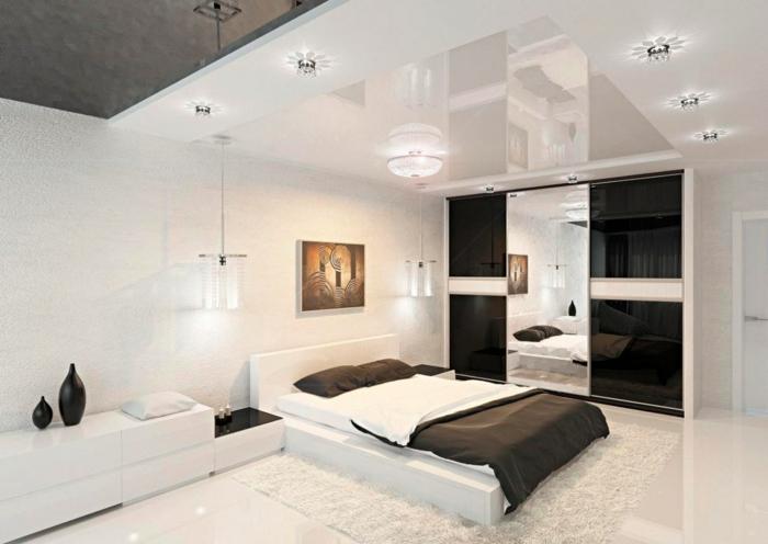 schlafzimmer weiß schwarze spiegeloberflächen teppich