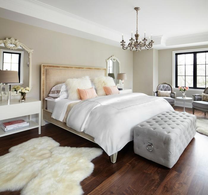 schlafzimmer weiß weiße bettwäsche schlafzimmerbank beige wände fellteppich
