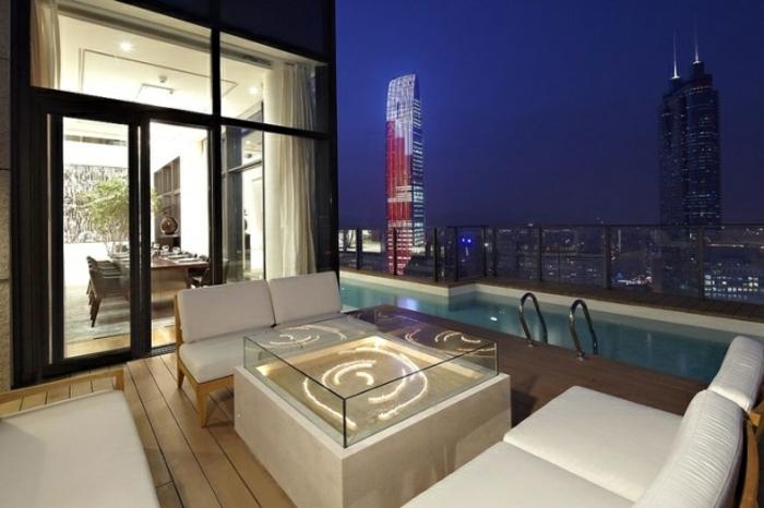 terrasse gestalten terrassenüberdachung feuerstelle gartenmöbel entspannung