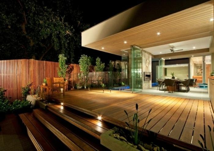 terrassenüberdachung feuerstelle gartenmöbel holzboden
