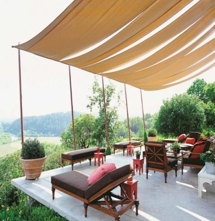 terrassenüberdachung feuerstelle gartenmöbel vorhang