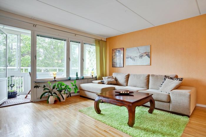 wandgestaltung ideen akzentwand orange grüner teppich pflanzen wohnideen wohnzimmer