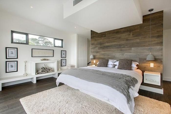 weißes schlafzimmer weiße wände beiger teppich holzwand akzentwand kamin