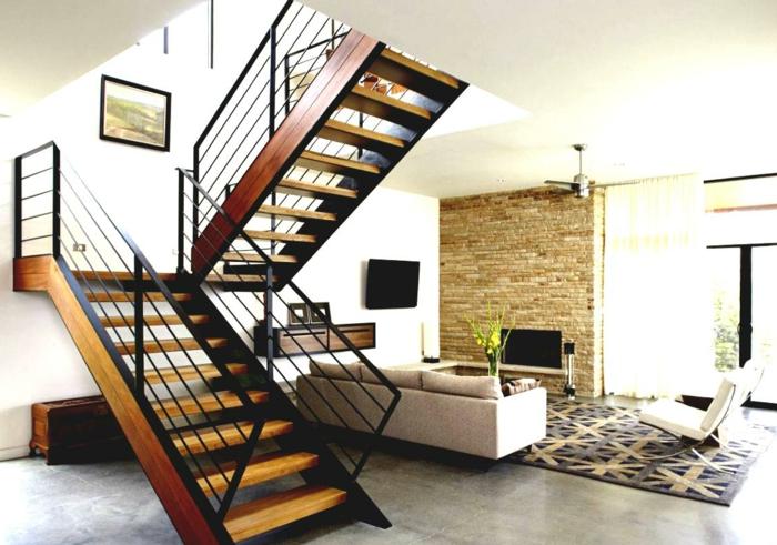 wohnideen wohnzimmer geometrischer teppich steinwand treppenhaus weiße wände