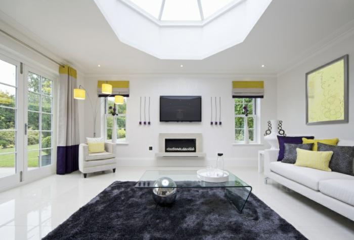 wohnideen wohnzimmer grauer teppich glastisch weiße wände gelbe akzente