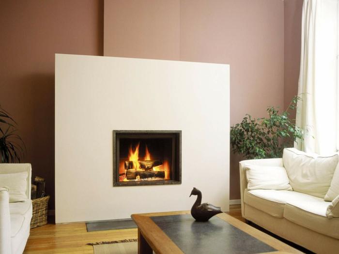 wohnideen wohnzimmer moderne feuerstelle rustikaler couchtisch pflanzen
