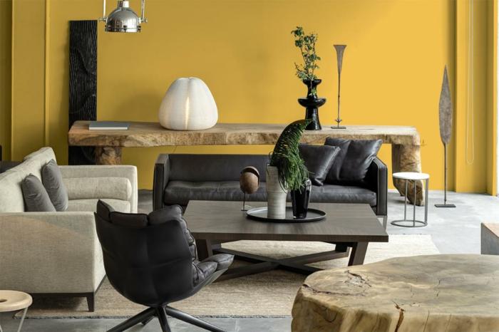 wohnideen wohnzimmer rustikale elemente gelbe wände schwarze ledermöbel essbereich